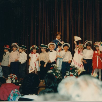 Children performing in a pageant at Tower School