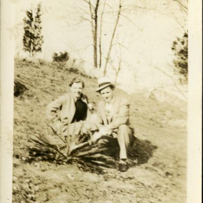 Gwen Ketchum sits next to a man on a hillside