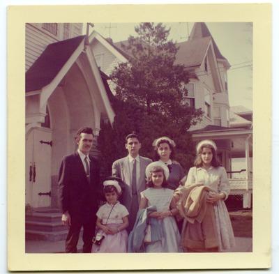 Miriam Arrango with her family outside a church
