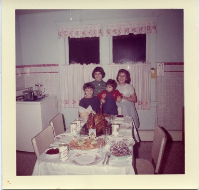 Miriam Isidro Arrango with other children at a holiday dinner