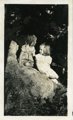 Gwen Ketchum plays with a childhood friend on a rock