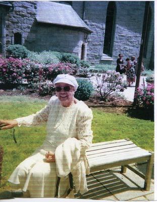 Lula Ann Blackson sitting outside a church