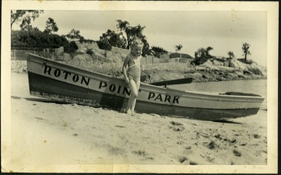 Gwen Ketchum stands by a canoe labelled Roton Point Park