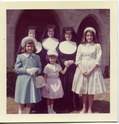 Miriam Arrango as a girl standing with family and nuns