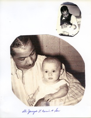 Dr. Joseph L. Carwin holding his infant son