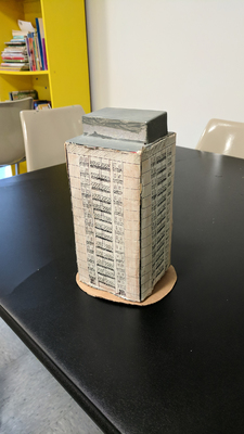 Model of an apartment building made by Rosebud Davis for the March for Affordable Housing