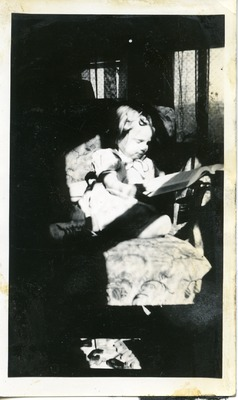 Gwen Ketchum reading a book as a child