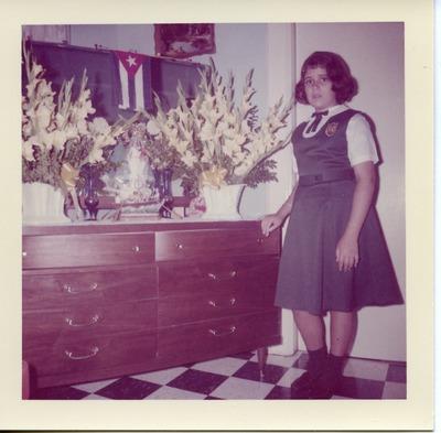 Miriam Arrango as a girl wearing her school uniform