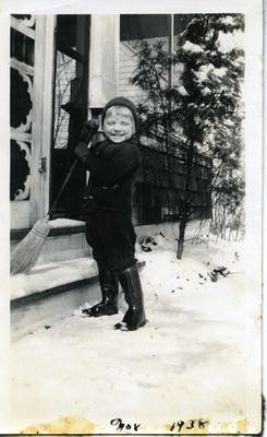 Gwen Ketchum sweeping snow off the front steps