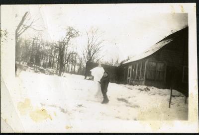 Gwen Ketchum stands by a snowman