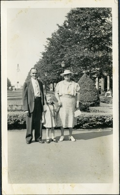 Gwen Ketchum stands with her grandparents in a park
