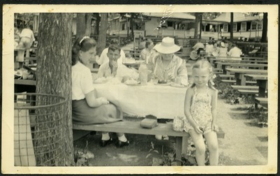 Gwen Ketchum sits with family members at a picnic bench