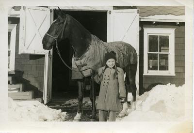 Gwen Ketchum holding a horse's reins