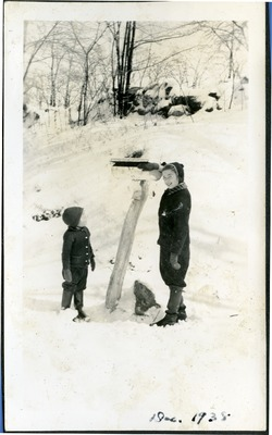Gwen Ketchum and a friend play in the snow