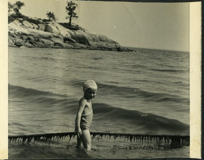 Gwen Ketchum plays in the water at Cove beach