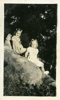 Gwen Ketchum and childhood friend sitting on a rock