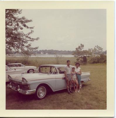 Miriam Arrango with her parents and a car