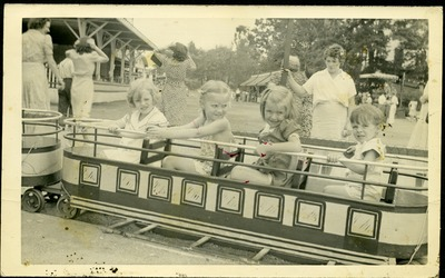 Gwen Ketchum and childhood friends ride a train in an amusement park