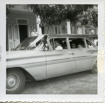 Miriam Arrango in a car with her family in Kingston, Jamaica